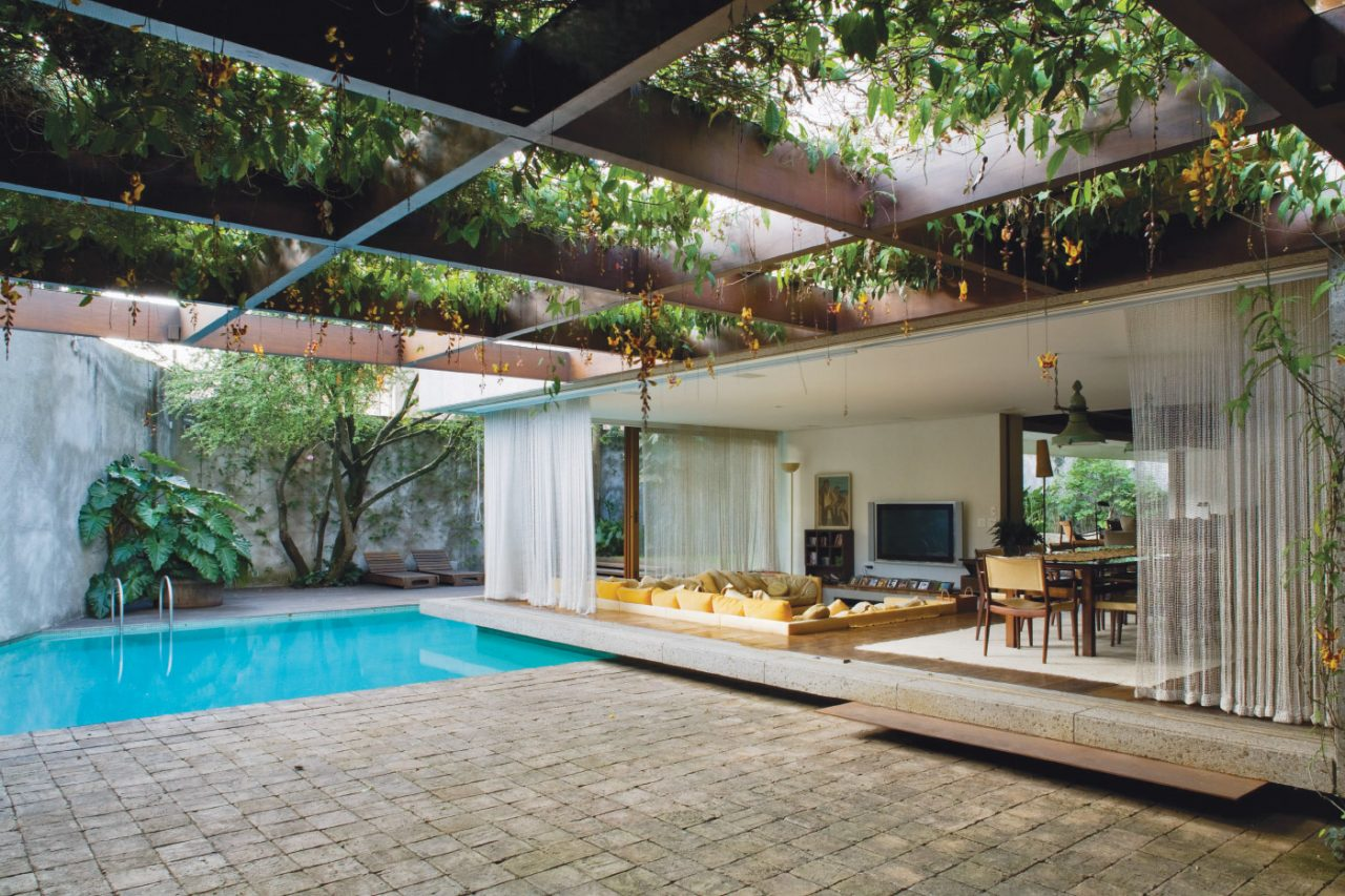 Interior photo of a covered patio and pool