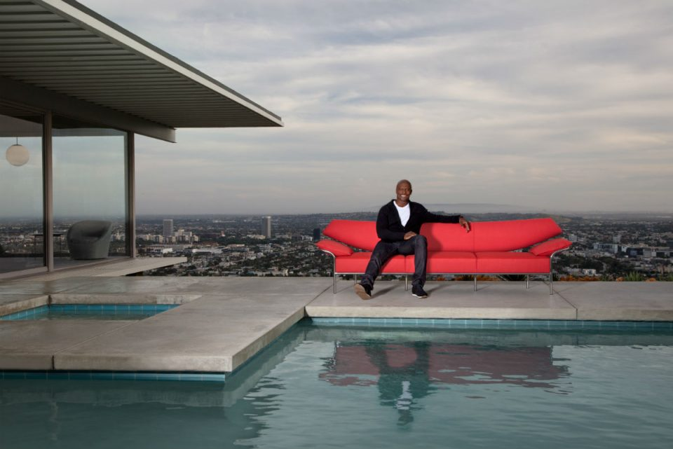 A man on a cliffside couch