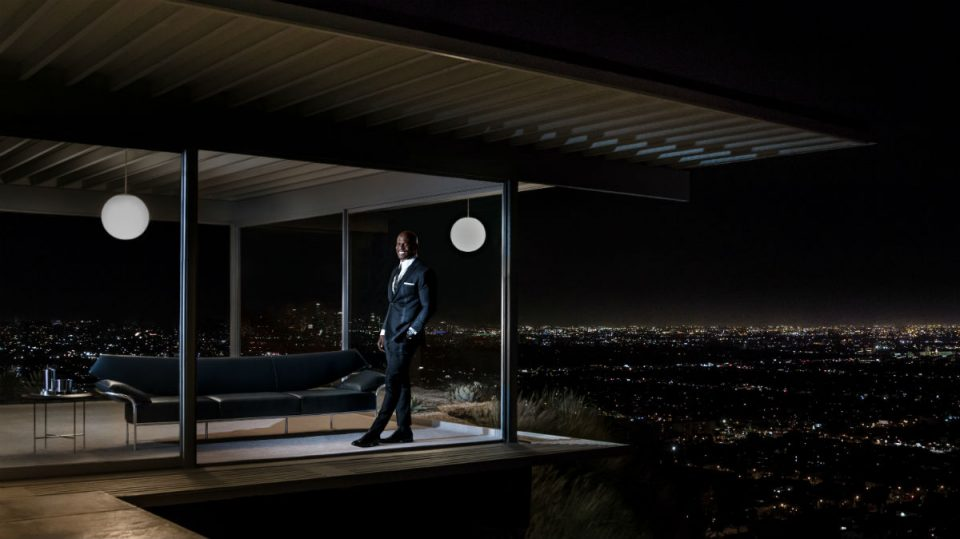 Image of a man standing in a window at night