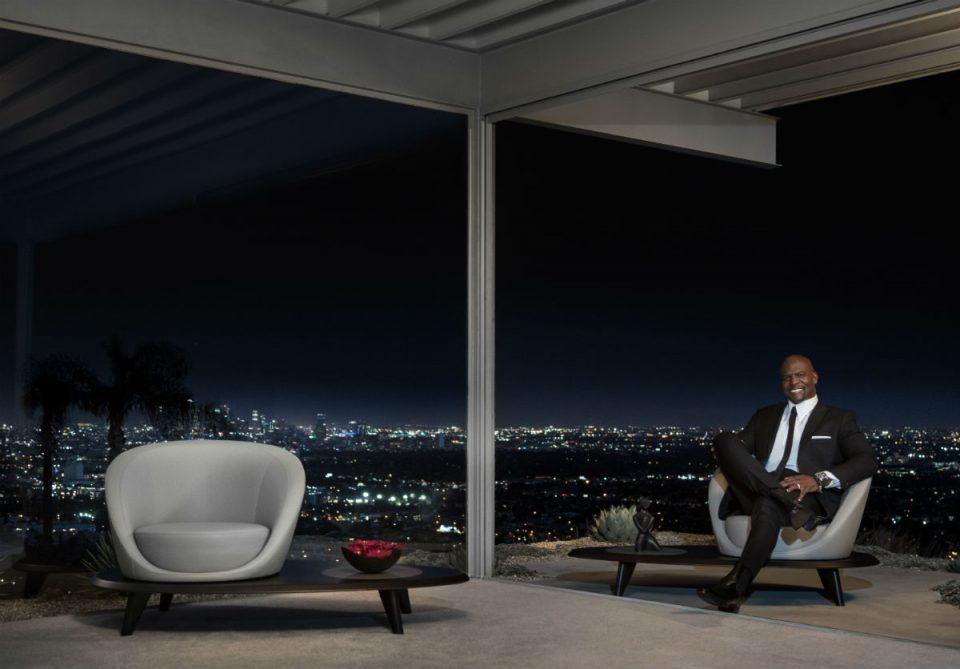 A man sitting on a sofa inside a house