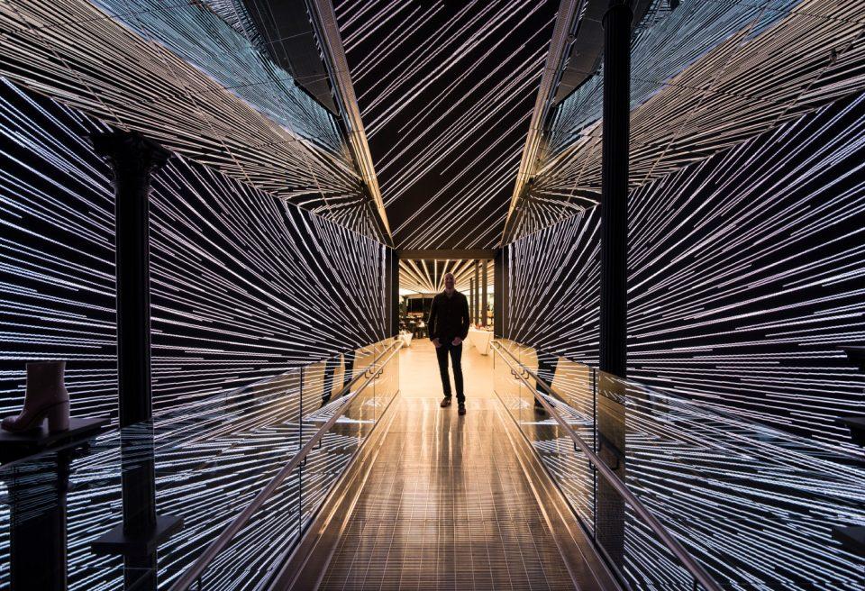 A man in a lit hallway