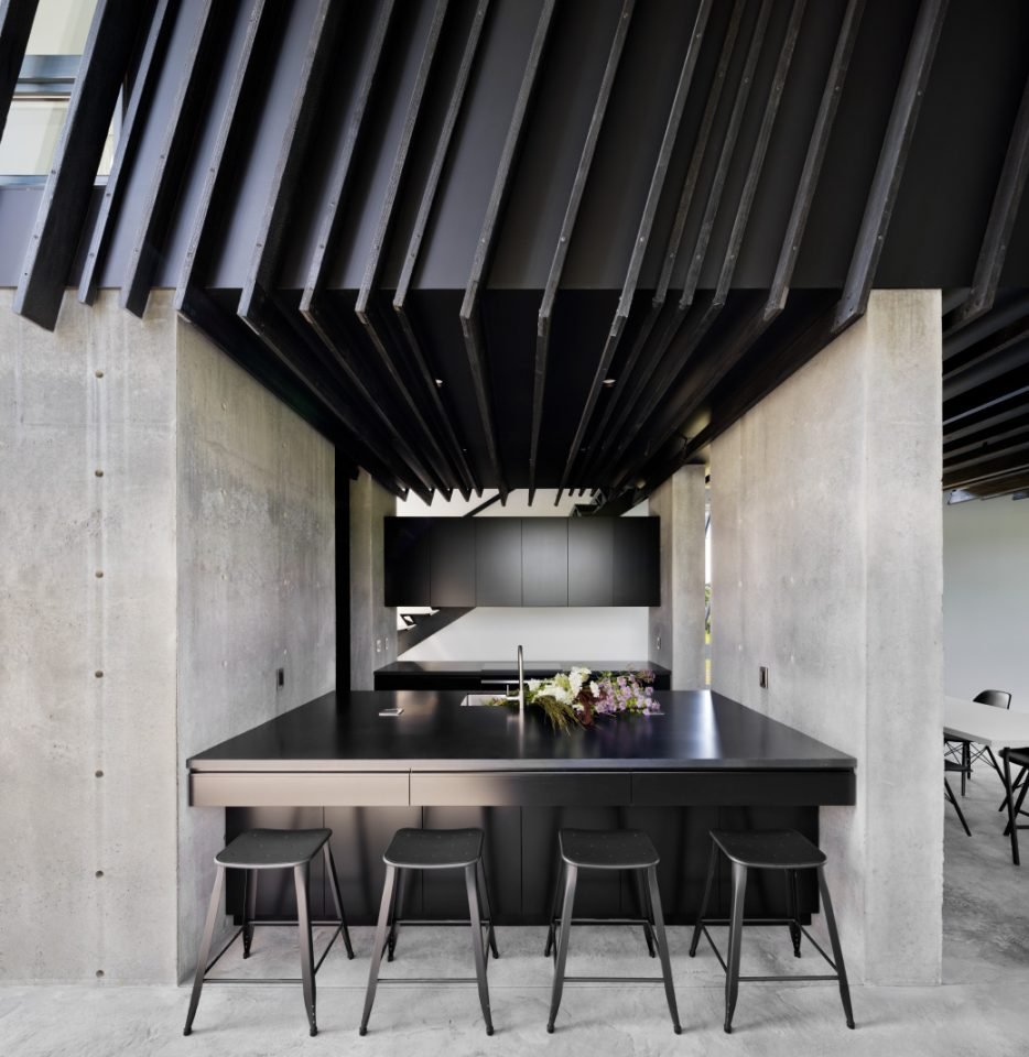 A concrete and charred wood kitchen