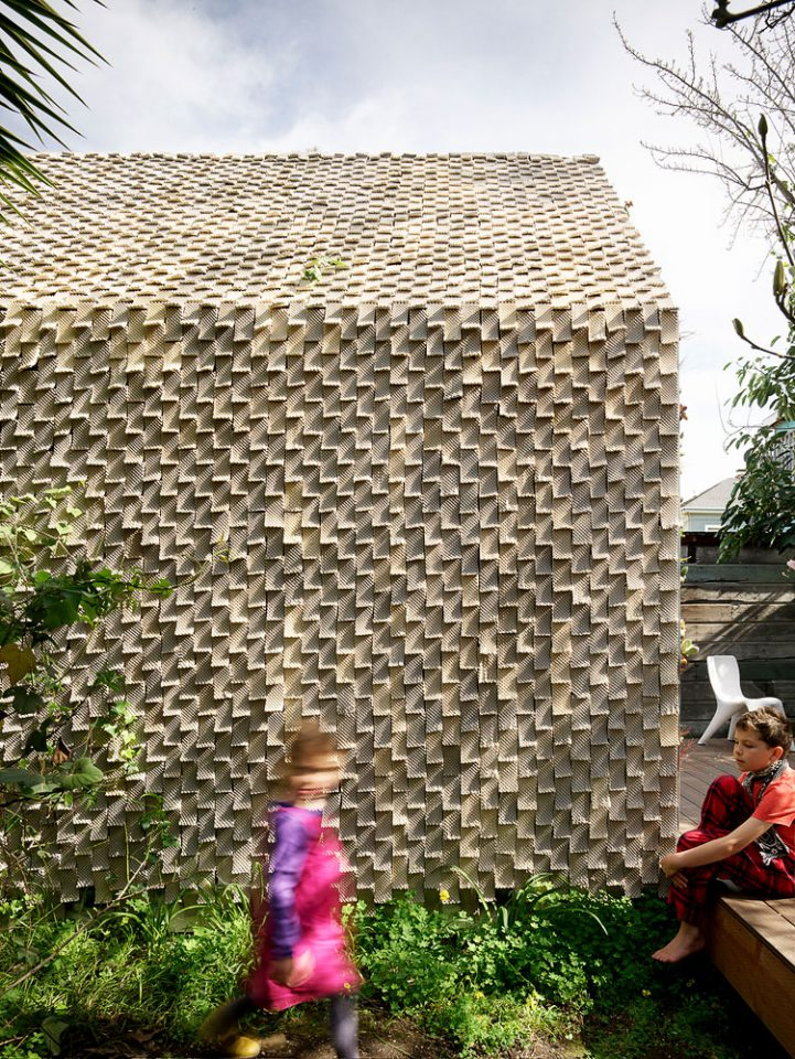 A cabin exterior clad in knurled tiles