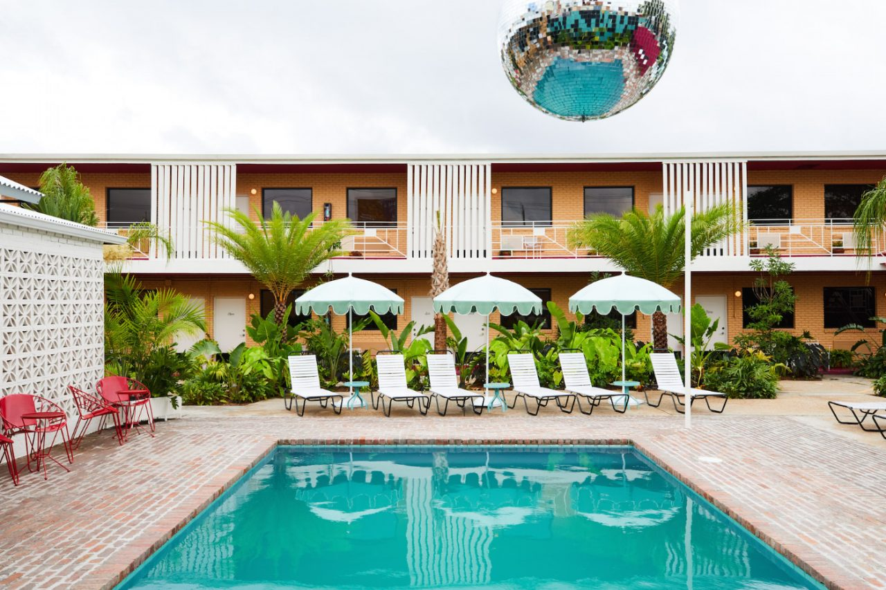 An outdoor pool and disco ball