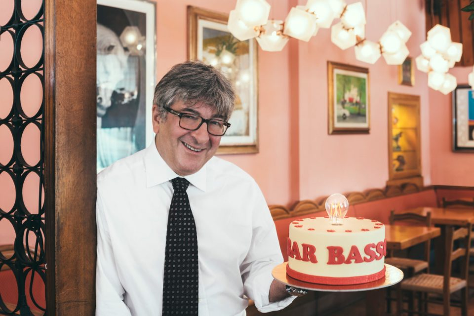 A man holdering a cake