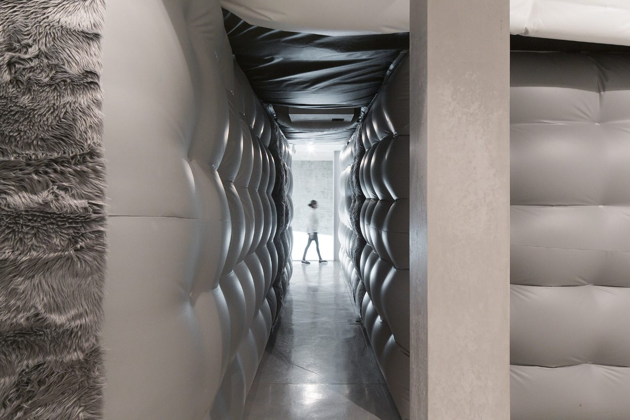 Person walking past an inflatable hallway