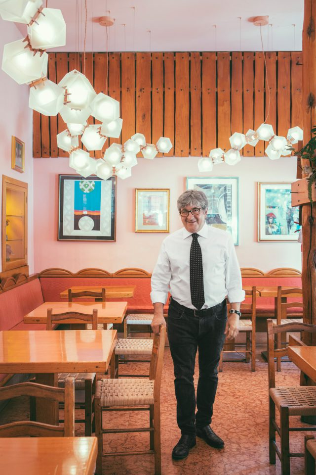 Bar Basso's beloved owner and bartender Maurizio Stocchetto with a new lighting installation by Gabriel Scott.