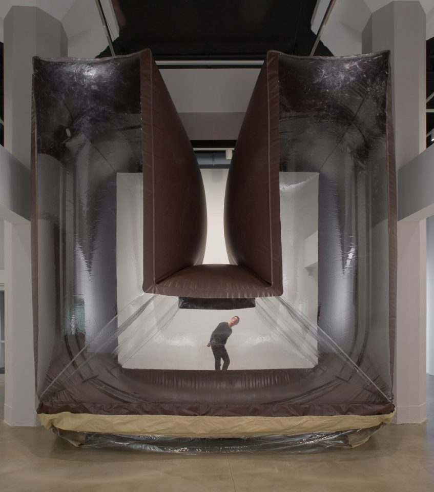 A U-shaped inflatable enclosure