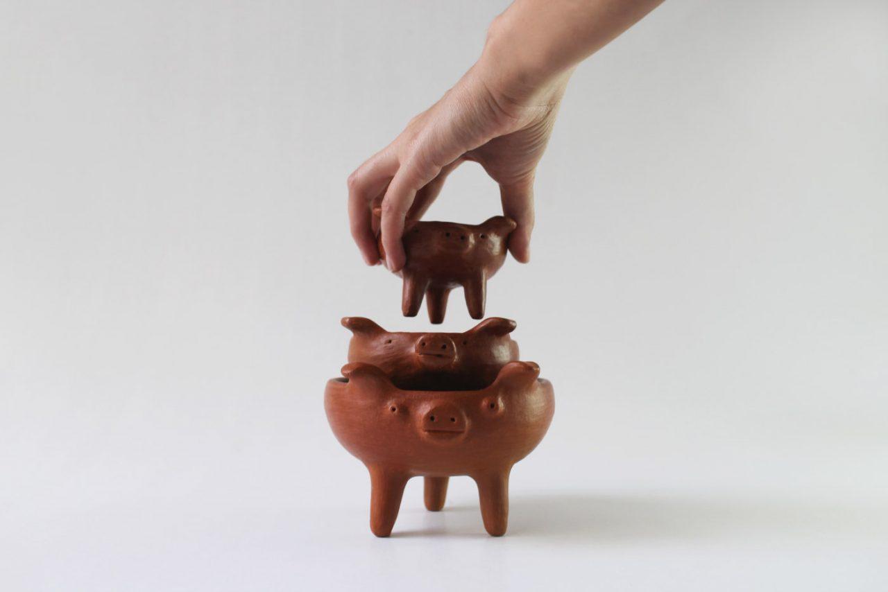 Three bowls shaped like pigs