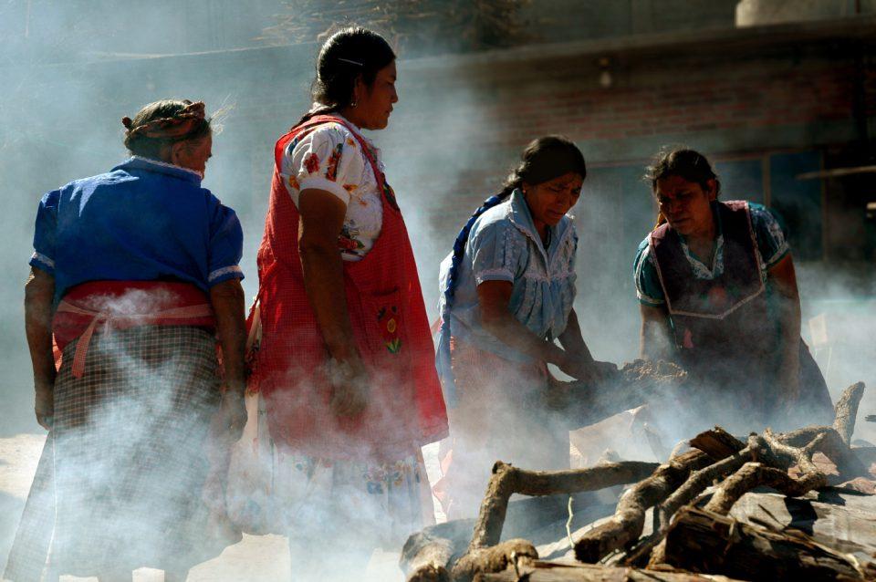 Indigenous women making ceramics