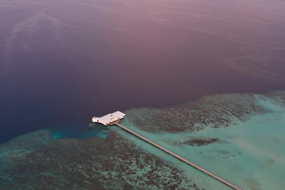 Photo of a long pier over the ocean