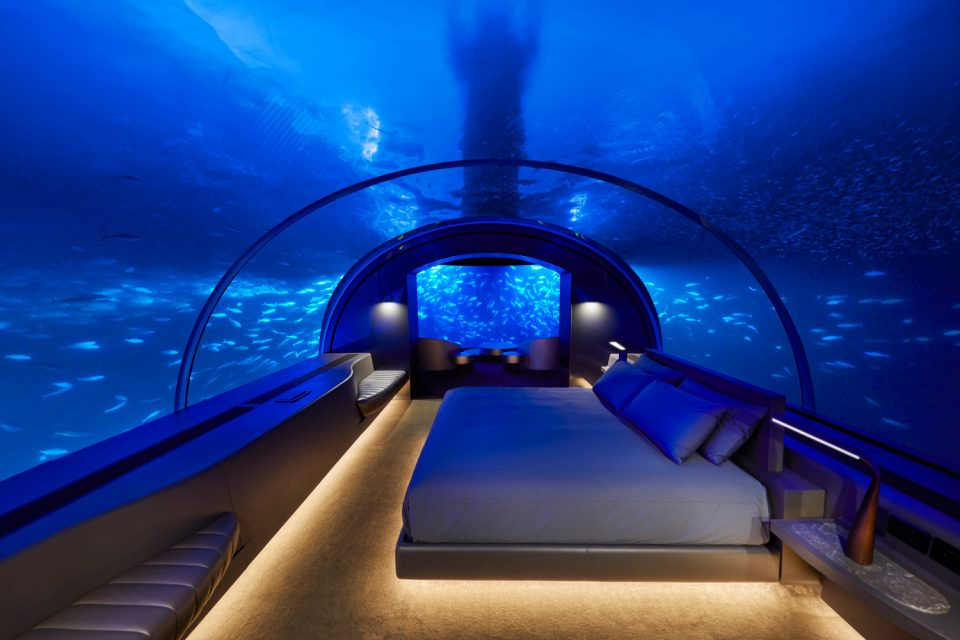 Photo of an underwater glass hotel room