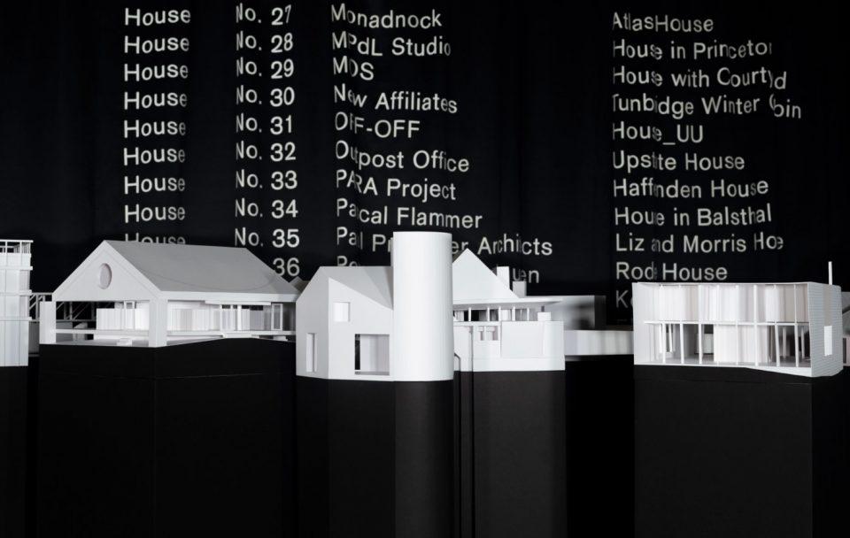 White house models on a black background