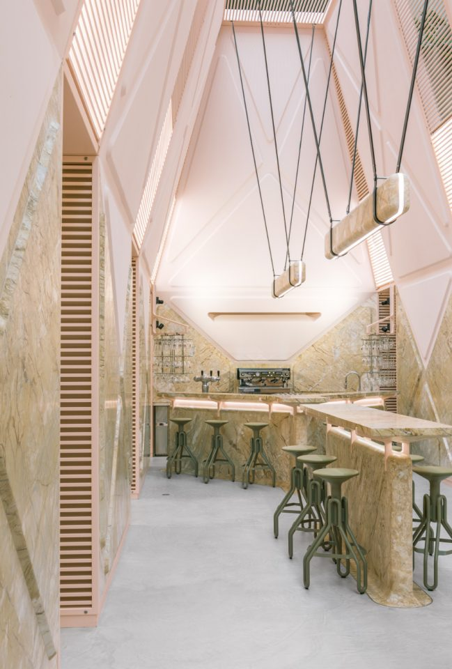 A cafe clad in pink stone