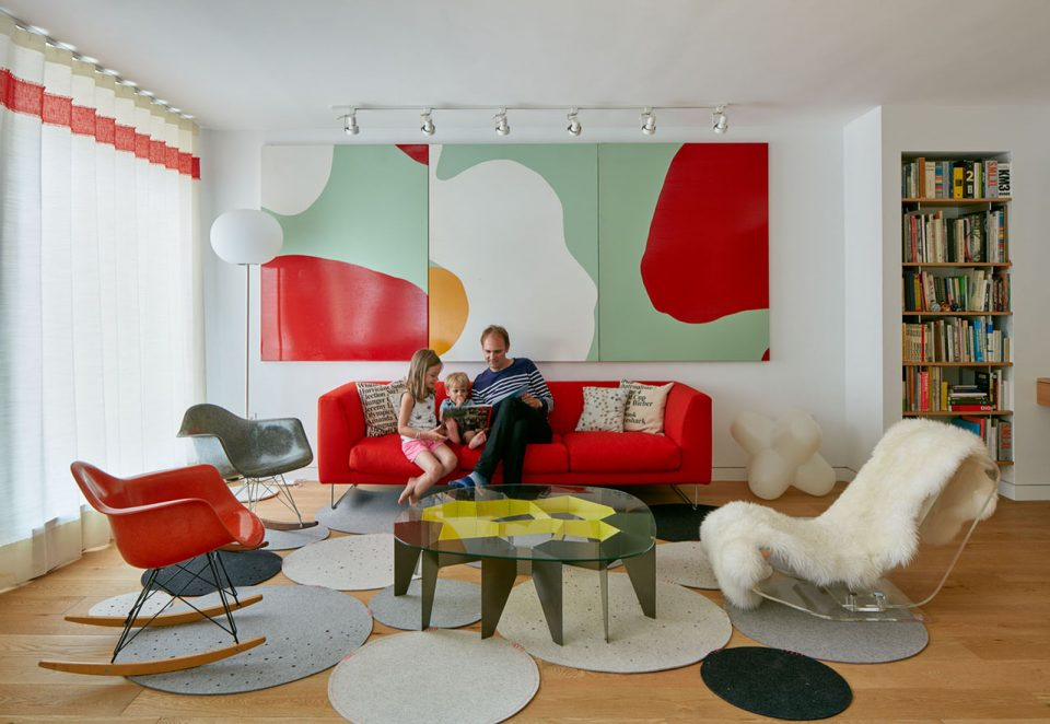 photo of a man and children sitting on a sofa in a living room