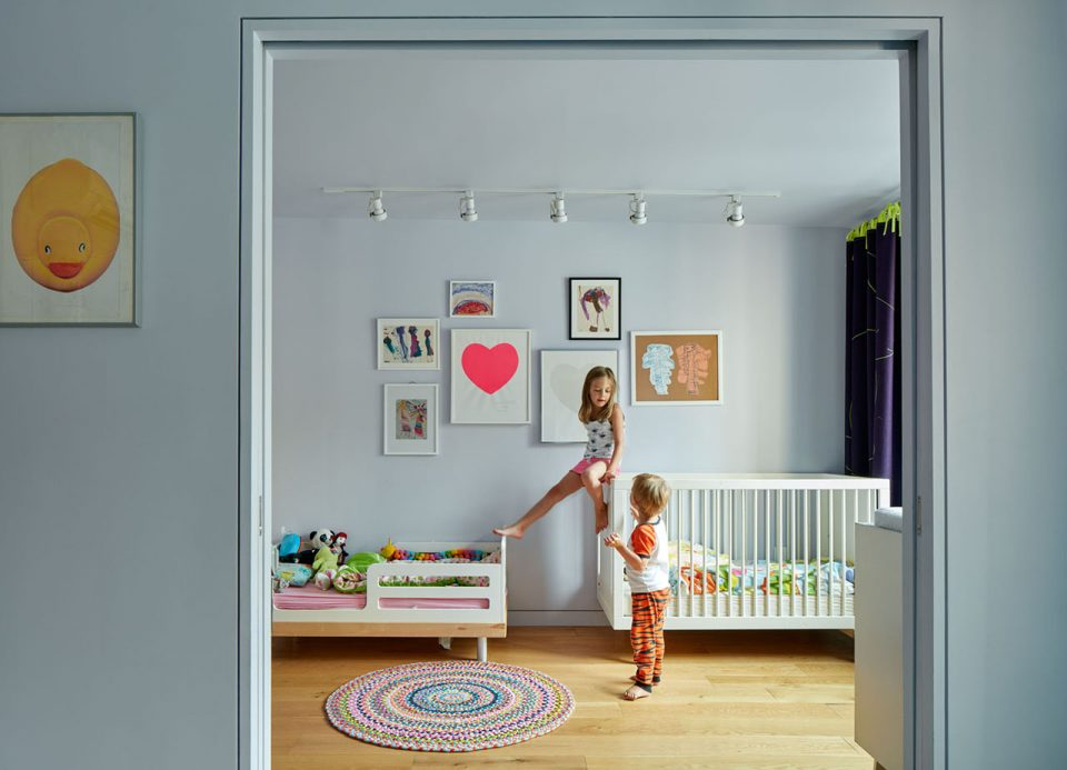 Photo of two children in a bedroom