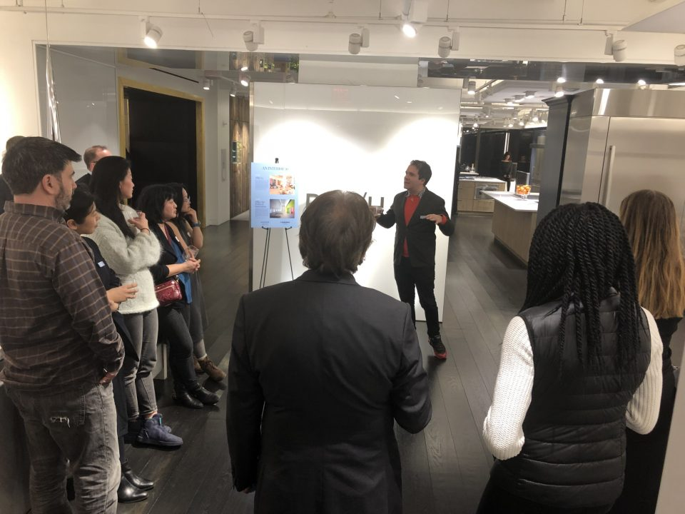 Photo of a person speaking in a showroom