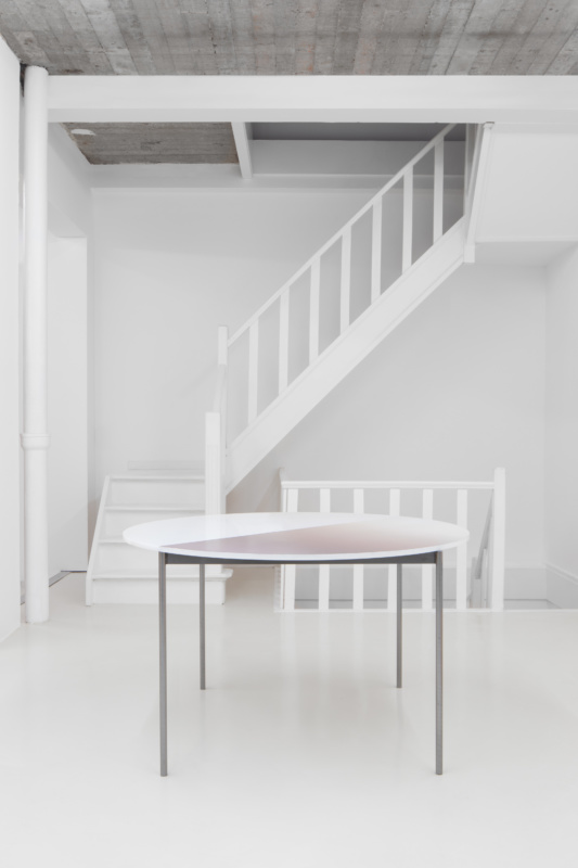 a table in front of a staircase