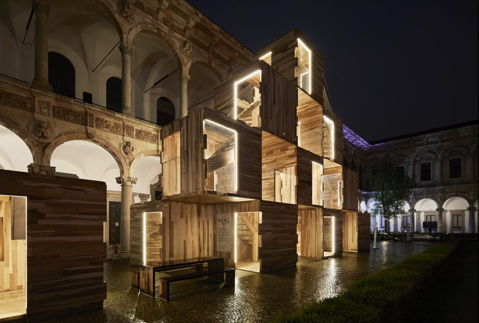 Image of stacked boxes lit up at night