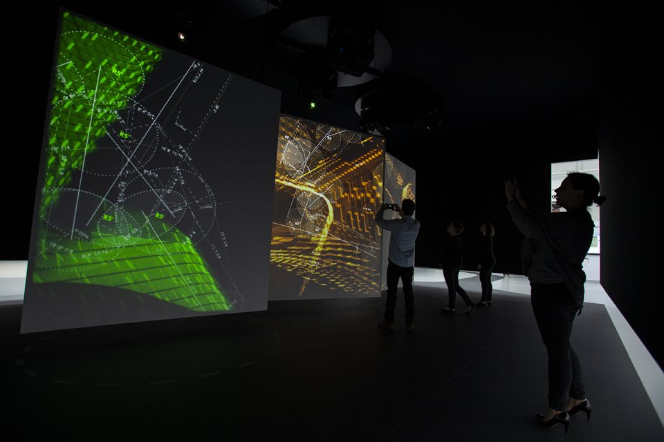 Image of viewers inside interactive digital installation