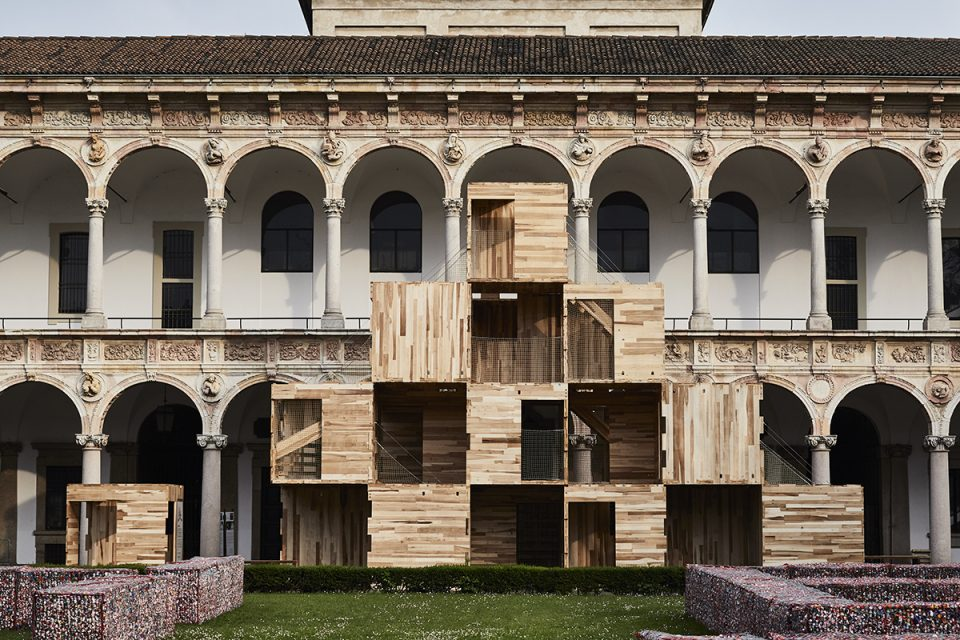 Image of stacked boxes in Italian courtyard
