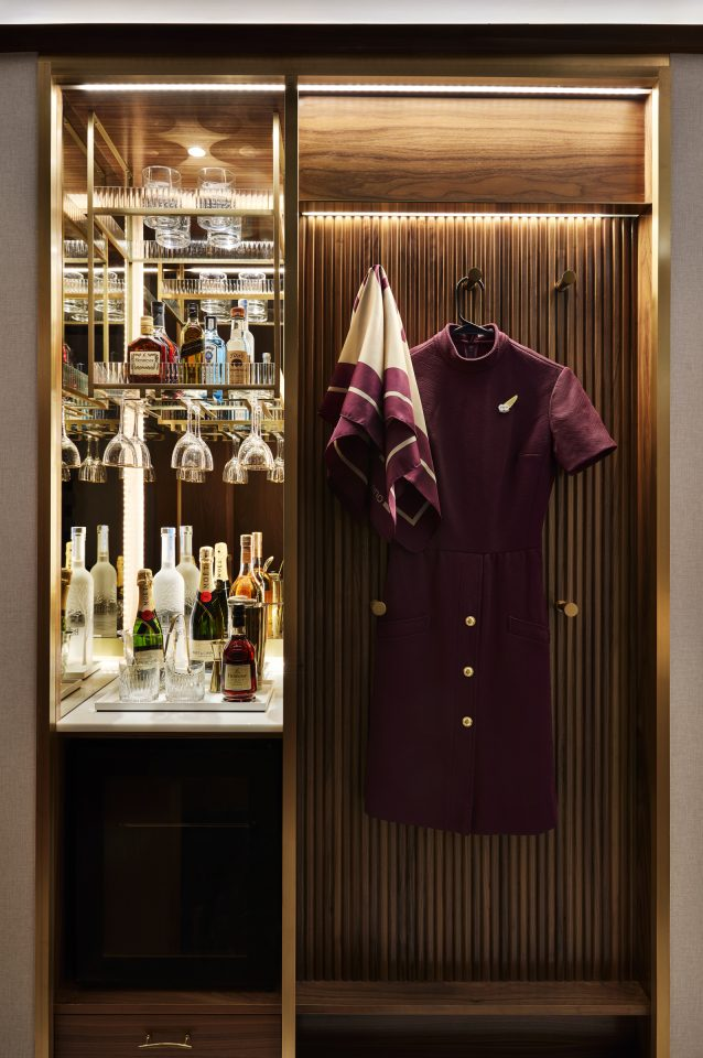 Up close image of closet and mini bar with bottles of alcohol and glasses