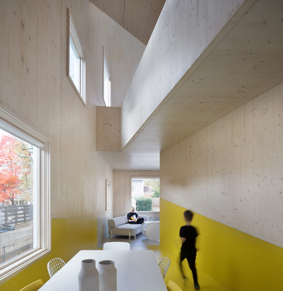 Image of Haus Gables interior with CLT exposed walls and yellow paint