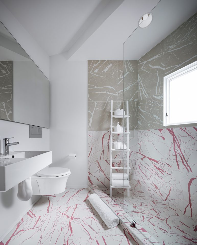 Image of Haus Gables white and pink bathroom
