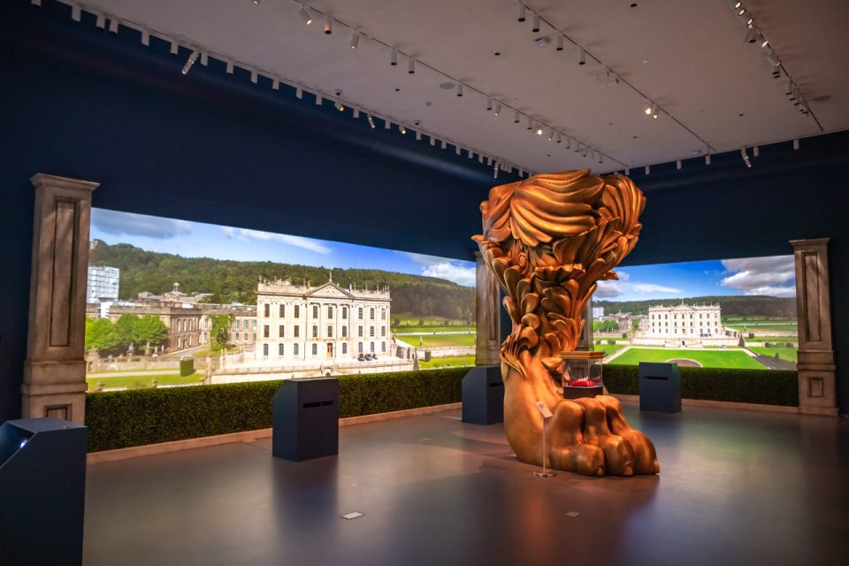 A 12-foot-tall lion's leg in the middle of a darkened gallery