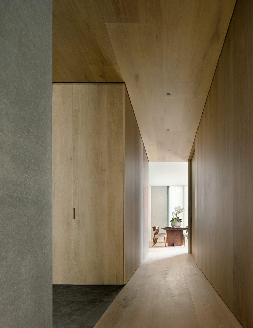 Photo of wood-clad interior hallway in apartment