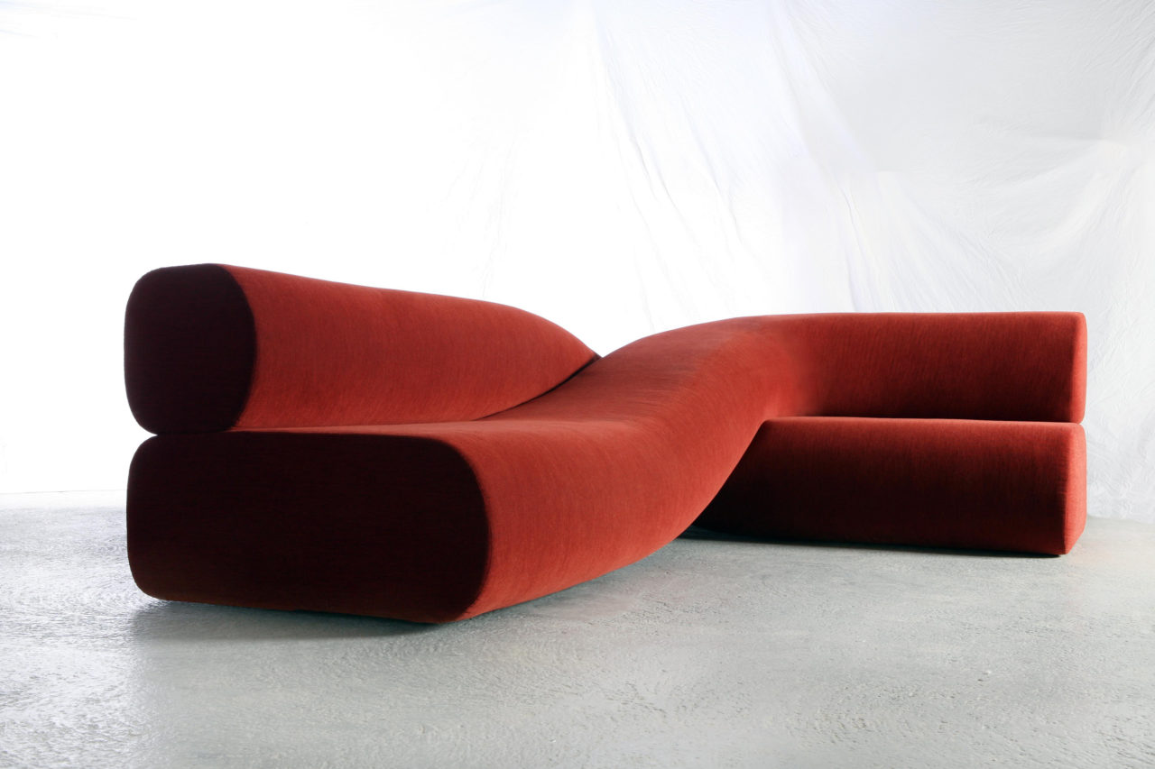 a sofa in front of a white backdrop